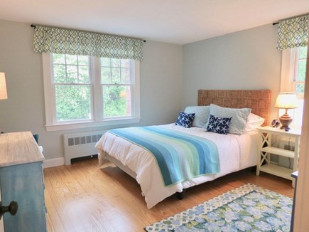 East Orleans Cape Cod vacation rental - Queen bedroom w/seagrass headboard and hand painted bureau.