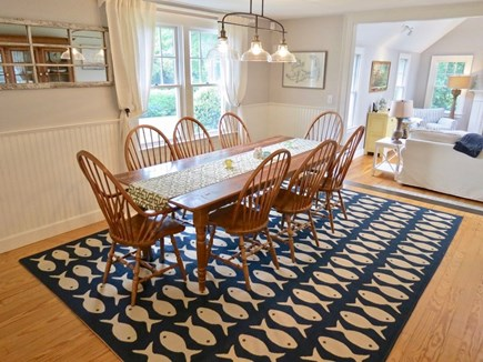 East Orleans Cape Cod vacation rental - Dining Area - hutch (not seen here) with serviceware, stemware.