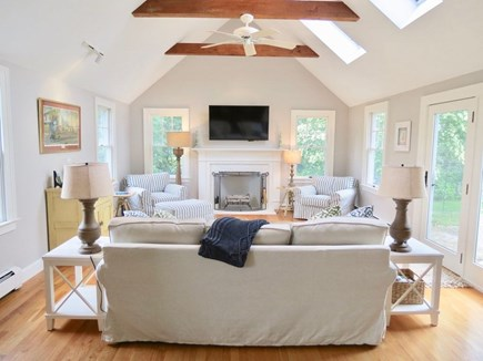 East Orleans Cape Cod vacation rental - Livingroom with skylights. French doors to patio w/firepit.