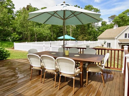 East Orleans Cape Cod vacation rental - Pottery Barn table on large deck. Market umbrella.
