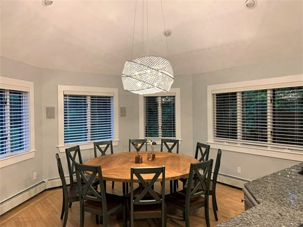 Orleans Cape Cod vacation rental - Dining Rm w/ 6 ft diameter table w/ 10 chairs & cathedral ceiling