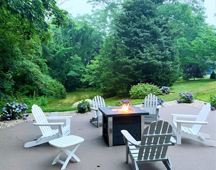 Orleans Cape Cod vacation rental - Lower Patio w/ New Adirondack Chairs & Gas Fire Pit
