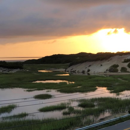 Provincetown Cape Cod vacation rental - Sunset over dunes under dense clouds