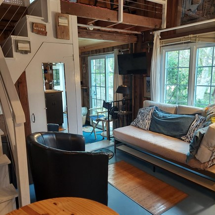 Truro Cape Cod vacation rental - Living/dining area, bedroom behind stairs