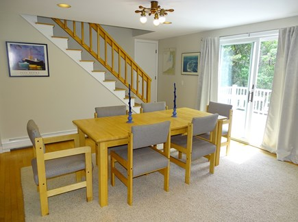 Wellfleet, Indian Neck Cape Cod vacation rental - Dining area and stairs to loft, slider to deck