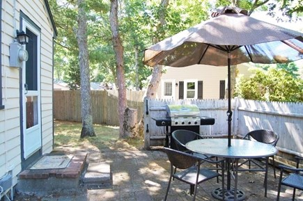 Yarmouth, Cottage is just of of Route 28 Cape Cod vacation rental - Patio Area with Grill