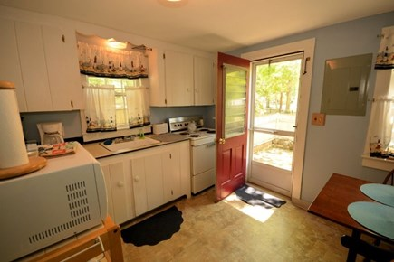Yarmouth, Cottage is just of of Route 28 Cape Cod vacation rental - Eat-in kitchen with access to the back yard