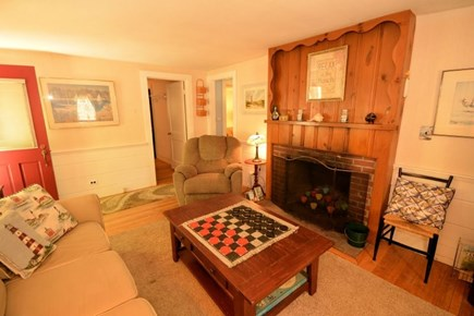 Yarmouth, Cottage is just of of Route 28 Cape Cod vacation rental - Reverse angle of Living Room with entrance and fireplace