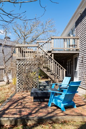South Chatham Cape Cod vacation rental - Back Deck with Patio and Fire pit