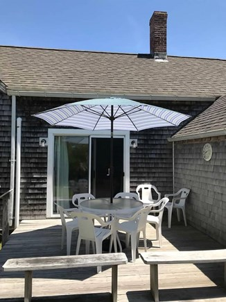 Harwich Cape Cod vacation rental - Back deck with ample seating (access off dining room via slider)