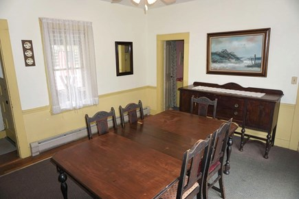 Harwich Cape Cod vacation rental - Dining room, table seats 6, with slider to back deck