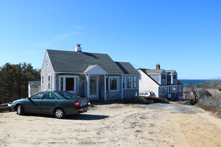 Truro Cape Cod vacation rental - Front of house with peek of shed and bay
