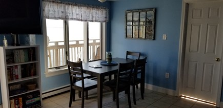 Truro Cape Cod vacation rental - Dinner for six by the bay window.