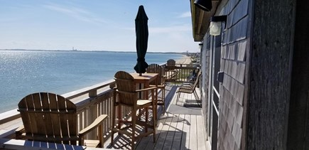 Truro Cape Cod vacation rental - Bar height furniture provides unobstructed view of Provincetown.