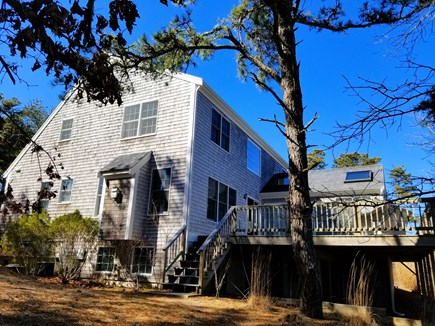 Wellfleet Cape Cod vacation rental - Sliders and stairs lead to deck with wooded views