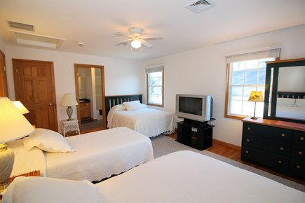 Wellfleet Cape Cod vacation rental - Second floor bedroom with two doubles, a twin and an ensuite bath
