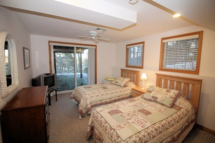 Wellfleet Cape Cod vacation rental - Lower level bedroom with two twins and slider