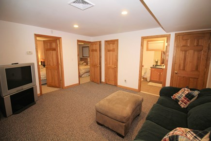 Wellfleet Cape Cod vacation rental - Lower level sitting room with sofa and TV