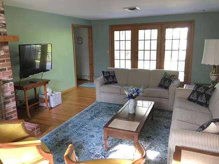 Dennis Cape Cod vacation rental - Family room with glass doors to back deck, BBQ and pond
