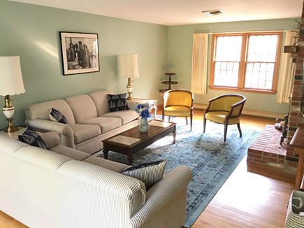 Dennis Cape Cod vacation rental - Family room with fireplace and windows to front yard