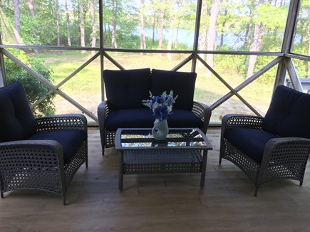 Dennis Cape Cod vacation rental - Screened in porch, back yard and pond