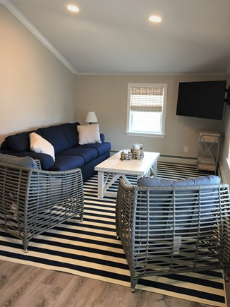 West Yarmouth Cape Cod vacation rental - Comfortable living room with slider to front porch