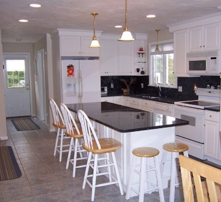 Wellfleet Cape Cod vacation rental - Granite countertop kitchen.  Open flow into dining & living room.