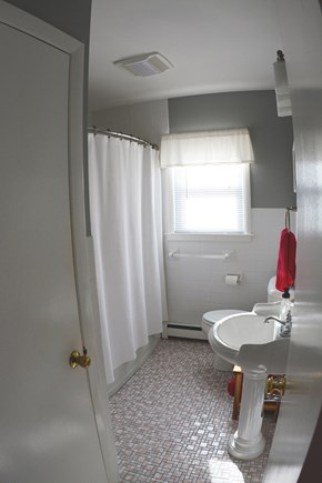 Plymouth MA vacation rental - Main floor Bath - Tub/shower, toilet and sink.