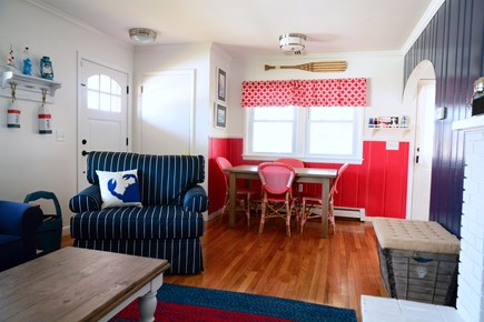 Plymouth MA vacation rental - Living room and kitchen table—extends for additional seating.