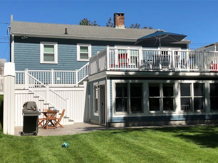 Plymouth MA vacation rental - View of over sized deck, patio and sunroom