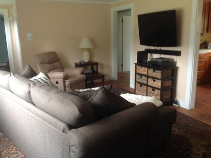 Dennis Port Cape Cod vacation rental - Living room w/chaise sofa, power recliner, and large A/C unit.