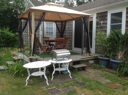 Dennis Port Cape Cod vacation rental - Deck with canopy, teak table & chairs, and gas grill