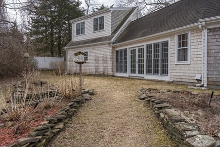 Barnstable Village Cape Cod vacation rental - Back Yard Rock Gardens. Sun room Doors To Back Yard.