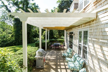 Barnstable Village Cape Cod vacation rental - Front Patio with Grill, Dining Area and Lounging Area.