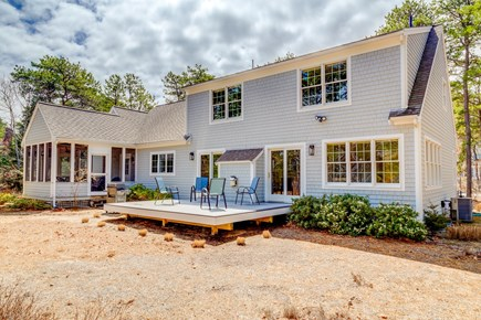 Eastham Cape Cod vacation rental - Backyard deck with grill.