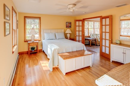 Eastham Cape Cod vacation rental - Master bedroom features a queen bed/en suite bath.