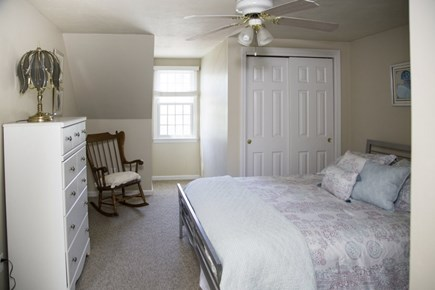 Hyannis Cape Cod vacation rental - Upstairs bedroom #1:  queen bed with vanity and half bath