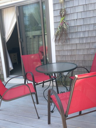 Hyannis Cape Cod vacation rental - Deck off lr with patio table & 4 chairs. Chaise lounge, gas grill