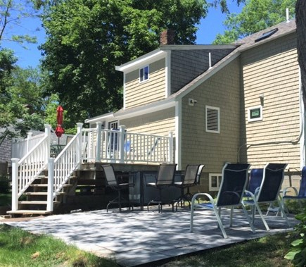 Brewster Cape Cod vacation rental - Rear of main house showing patio and deck with seating for 16