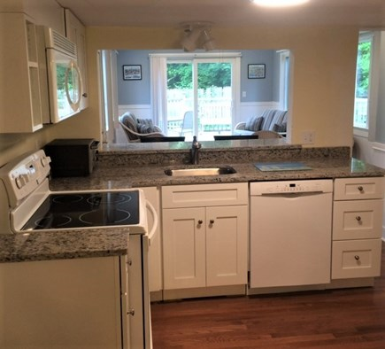 Brewster Cape Cod vacation rental - Kitchen with family room beyond- 2 bedroom house