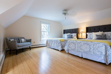 Chatham Cape Cod vacation rental - Upper level bedroom 2 with two queens and ceiling fan, window AC