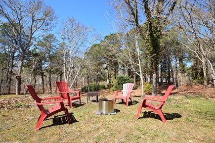 Chatham Cape Cod vacation rental - Fire pit and outdoor seating in the backyard
