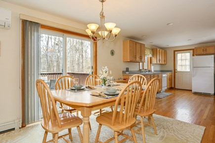 Eastham Cape Cod vacation rental - Dining room with backyard view & sliders to deck