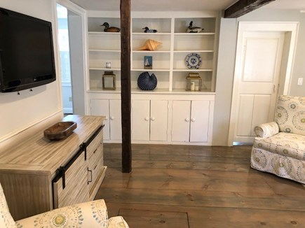 South Yarmouth Cape Cod vacation rental - Bookcase in main living room