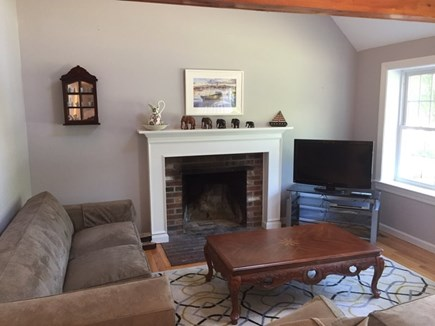 Hyannis Cape Cod vacation rental - Living Room with vaulted ceilings, two large couches and TV.