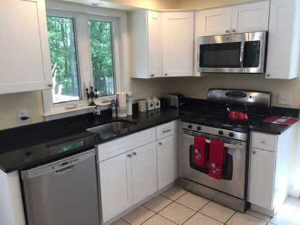 Hyannis Cape Cod vacation rental - Kitchen equipped with dishwasher, microwave, and oven.
