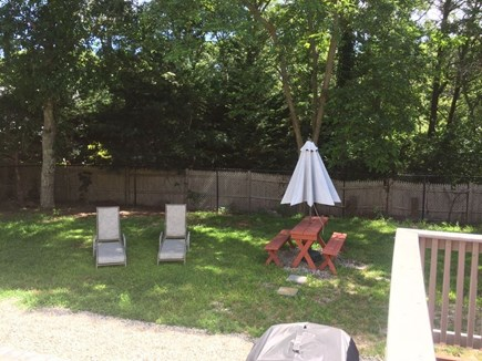 Hyannis Cape Cod vacation rental - Fenced in backyard with lounge chairs, perfect for kid's.