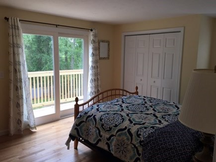 Hyannis Cape Cod vacation rental - Queen bed with full size closet and an attached deck.