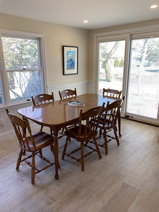 Barnstable Cape Cod vacation rental - Kitchen opens to backyard and deck with additional seating.