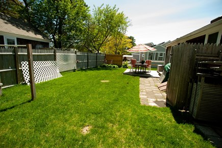 Dennisport Cape Cod vacation rental - Long view of the backyard where kids can play.